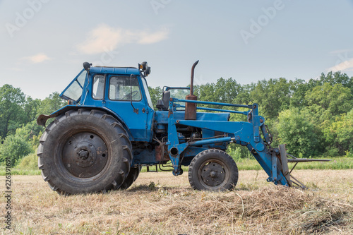 Tractor for working in the field and mowing grass. Agricultural machinery