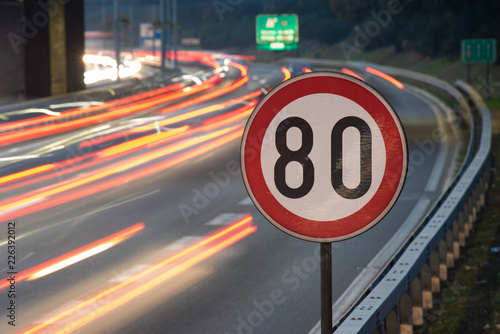Long exposure shot of traffic sign showing 80 km/h speed limit on a highway full Fototapeta
