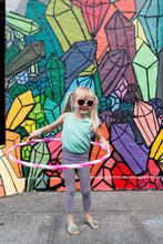 Young Girl With Hula Hoop And ...