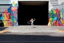 Little Girl Playing With Hula Hoop