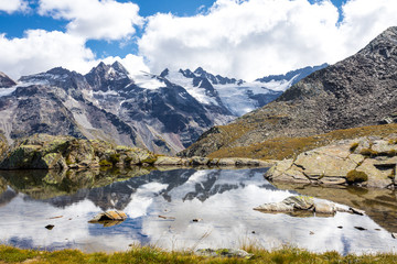 Gran Paradiso Alps mountain - mountain lake with reflections of clouds - Cogne Aosta Valley - Grand Paradis National Park
