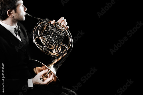 Fotoposter Muziek French horn player. Hornist playing brass orchestra music instrument