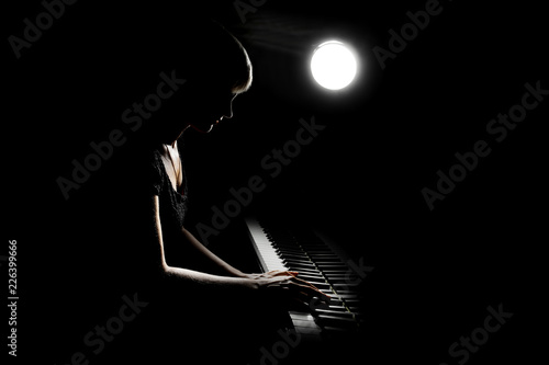 Piano player. Woman playing piano concert. Pianist classical musician - 226399666