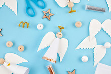 Creative Hobby. DIY Christmas Decoration. Process Of Making Handmade Christmas Paper Angels