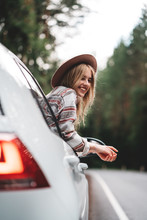Hipster Woman Traveling By Car...