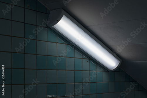 Closeup of a fluorescent light in a subway tunnel
