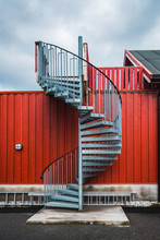 Winding Staircase Near Red Fence