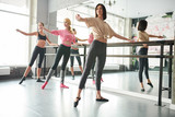Young women practicing ballet moves