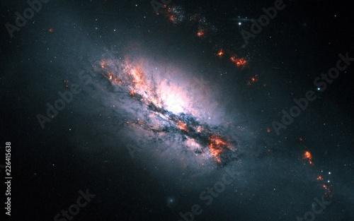 Barred Spiral Galaxy NGC-2146 Color-Enchanced Orange Nebula Galaxy Universe Background Wallpaper Original Image by NASA/ESA - 226415638