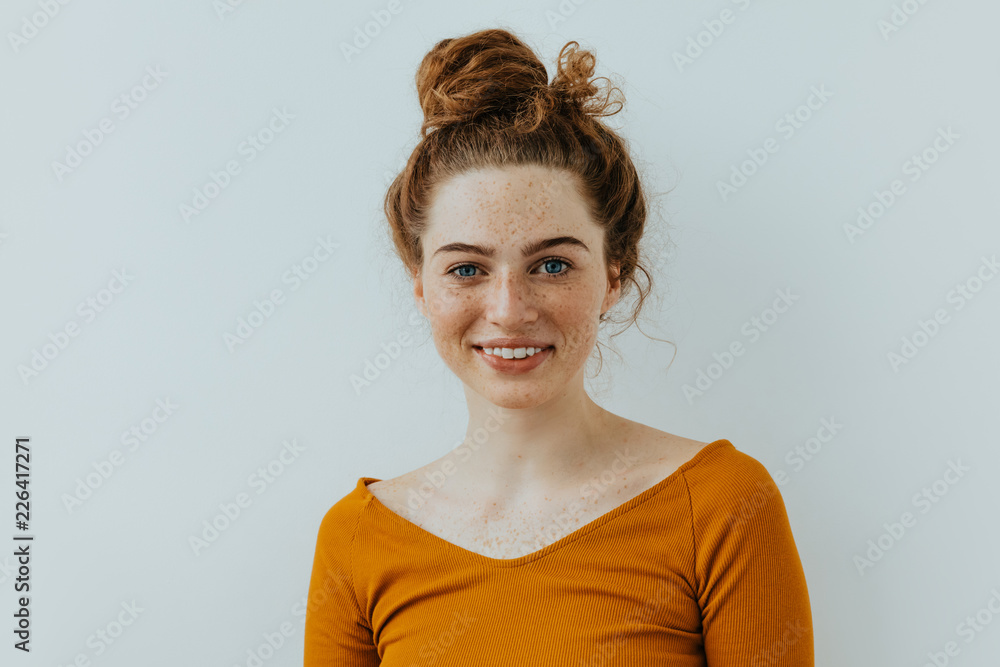 Fototapety, obrazy: Woman portrait. Style. Beautiful blue eyed girl with freckles is looking at camera and smiling, on a white background