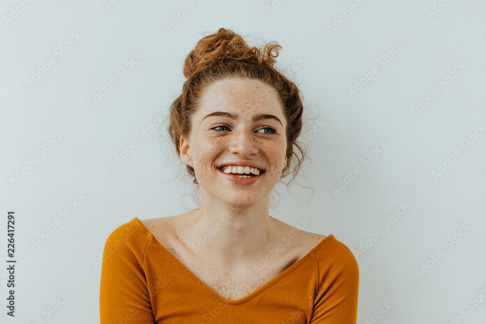 Fototapety, obrazy: Woman portrait. Happiness. Beautiful blue eyed girl with freckles is looking away and laughing, on a white background