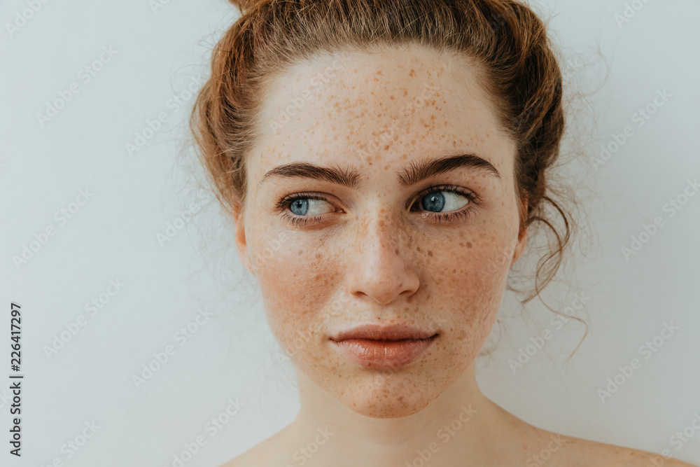 Fototapety, obrazy: Woman portrait. Close-up. Beautiful blue eyed girl with freckles is looking away, on a white background