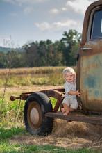 Baby/Toddler On An Old Car On A Farm