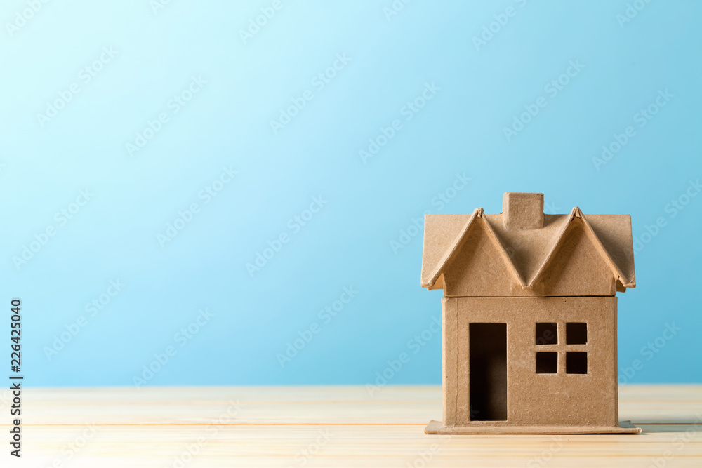 Fototapety, obrazy: Mini residential craft house on a blue background