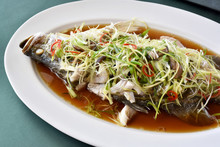 Fish Steamed In Soy Sauce, Snapper Boiled With Ginger And Spring Onion Sliced, Traditional Chinese Cooking Style, Healthy Clean Diet Food.