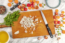 Prep Time, Or Mise En Place. An Overhead Photo Of Professional Chef's Knives, Shot From Above On A Cutting Board, With Chopped Vegetables And Spices, On A Marble Cooking Surface
