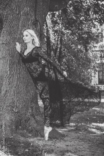 Fotobehang Illustratie Parijs Young modern ballet dancer in handmade lace sexy black long dress. Inspiration at life. City old Europe streets