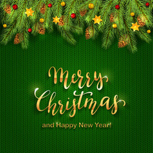 Christmas Lettering On Green Knitted Background With Holiday Decorations