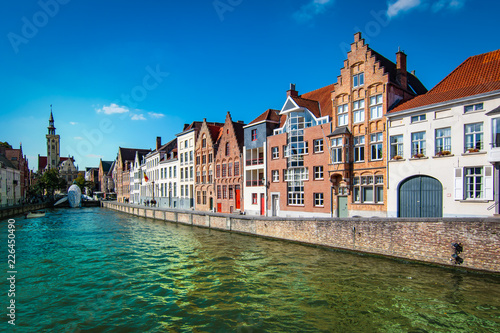 Scenic city view of Bruges canal with beautiful medieval houses.
