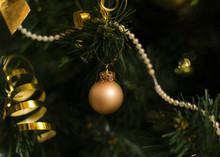 Orange Little Ball  Hanging On Christmas Tree