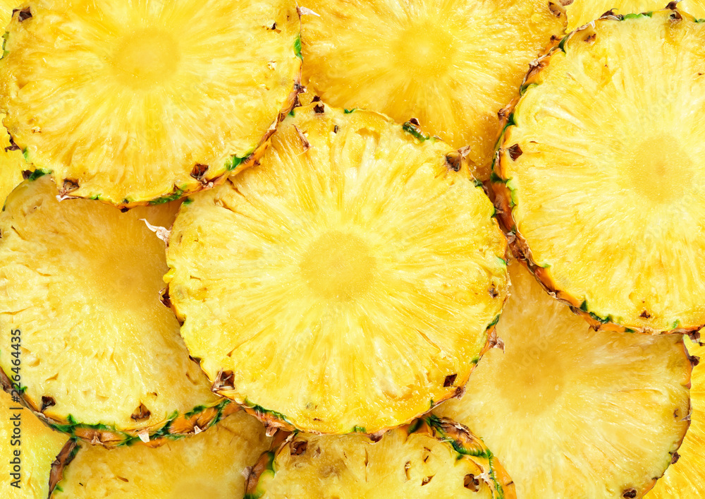 Fototapeta top view of sliced pineapple fruit as textured background