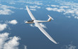 Segelflugzeug über den Wolken