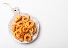 Curly Fries Fast Food Snack On Wooden Board On Stone Kitchen Background. Unhealthy Junk Food