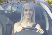 Young Girl Driving A Car