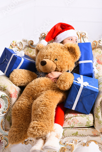 Adorable kid receives presents. Winter holidays and childhood