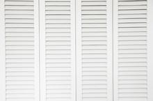 Plantation Style White Window Sun Shutters. Background Concept.