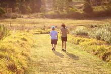 Brother And Sister Walking Awa...