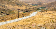 Road Winding Down A Valley Sur...