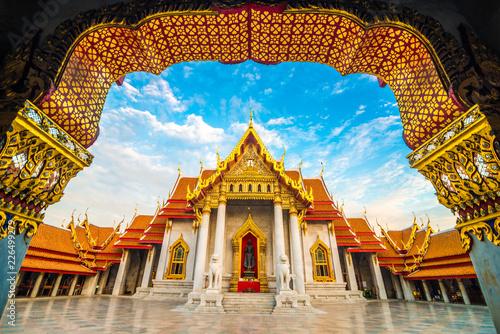 Foto op Canvas Bangkok Marble buddhist Bangkok Wat Benchamabophit temple evening sunset sky with cloud