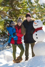 Happy Family With Snowman In W...