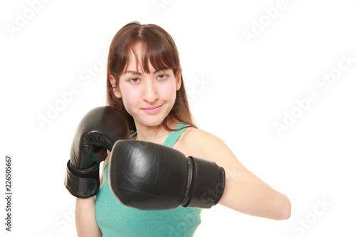 Fotografie, Obraz  左フックを打つ東欧人の女性ボクサー