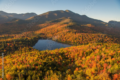 Morning light illuminates the fall color in the Adirondack Mountains over Heart Wallpaper Mural