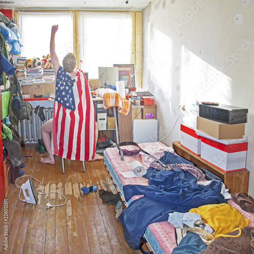 Messy superman's room. Piles of clothes, boxes, books Fototapeta
