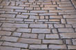 Old smooth paving stones of an old street in Rovinj, Croatia