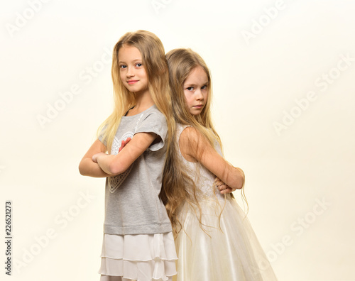 childhood. childhood happiness concept. happy childhood of two little girls isolated on white. childhood of two pretty fashion girls