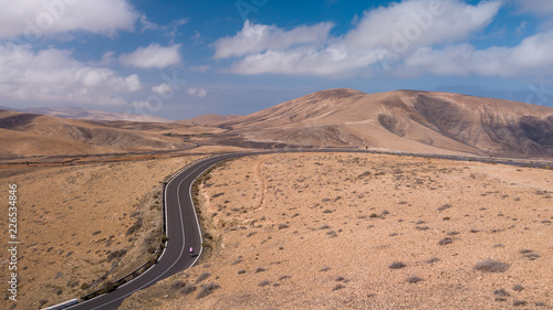 aerial view of road and volcanic mountain