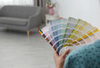 canvas print picture - Female interior designer with color palette samples indoors, closeup. Space for text