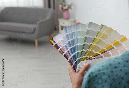 Obraz na płótnie Female interior designer with color palette samples indoors, closeup