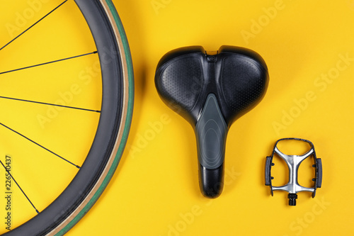 Set of different bicycle parts on color background, flat lay