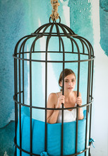 Captive In Fear. Modern Furniture Design And Home Comfort. Fashion Slave In Captivity Of Beauty. Woman Inside Iron Cage. Freedom Of Cute Girl In Cage Chair. Prisoner Woman In Cage - Home Confinement