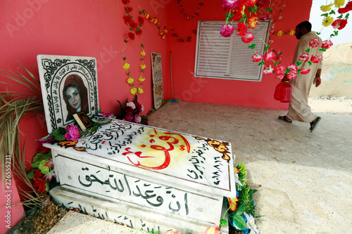 A worker is seen near the grave of the Instagram star and a