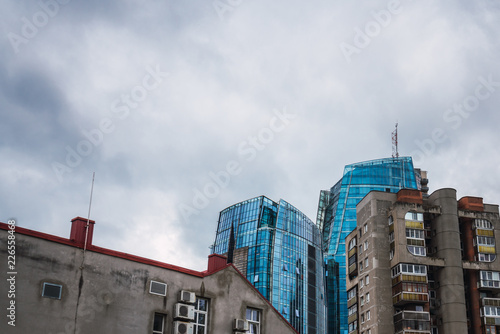 Cloudy sky over high-rise buildings