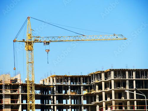Spoed Foto op Canvas Stad gebouw Construction site background. Crane near building.