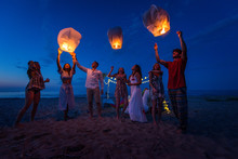 Group Of Friends Lighting Lant...