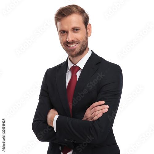 Obraz portrait of smiling businessman standing with hands folded - fototapety do salonu