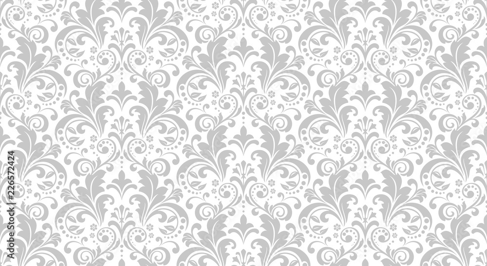 Fototapeta Wallpaper in the style of Baroque. Seamless vector background. White and grey floral ornament. Graphic pattern for fabric, wallpaper, packaging. Ornate Damask flower ornament.